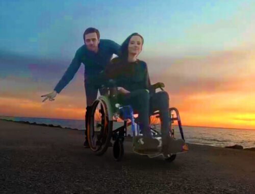 couple wheelchair beach sunset
